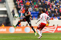 Brandon McDonald (4) of D. C. United p[lays the ball during the first half of a Major League Soccer (MLS) match against the New York Red Bulls at Red Bull Arena in Harrison, NJ, on March 16, 2013.