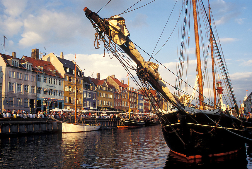 canal, Copenhagen, Denmark, Scandinavia, Sjaelland, Europe, Boats docked along Nyhavn (New Harbor) in the scenic city of Copenhagen