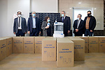 Vice President of the Office of the President Mahmoud Salama delivers Health Minister Mai Kilh 25 device respirator, in the West Bank city of Ramallah on March 25, 2021. Photo by Thaer Ganaim