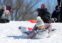 Monroe Bullington, 9, rides an inflatable Tuesday, February 16, 2021, down a hill at J.B. Hunt Park in Springdale. Temperatures dipped to 20 degrees below zero in some parts of the region over night Monday. Check out nwaonline.com/210217Daily/ and nwadg.com/photos for a photo gallery.<br /> (NWA Democrat-Gazette/David Gottschalk)