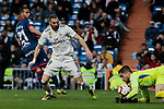 Real Madrid's Karim Benzema and SD Huesca's Roberto Santamaria during La Liga match between Real Madrid and SD Huesca at Santiago Bernabeu Stadium in Madrid, Spain. March 31, 2019. (ALTERPHOTOS/A. Perez Meca)