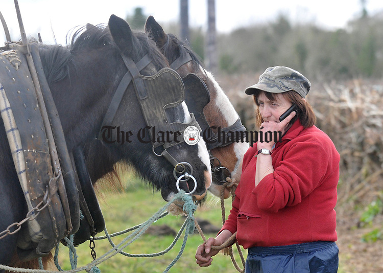 Mary Herlihy from Cork takes a call during the Clare Ploughing Championships in Newmarket at the weekend. Photograph by Declan Monaghan
