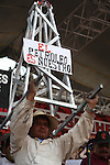 """A Mexican worker holds a banner that reads :The Oil is Ours"""" during a rally to commemorate the May Day in the Mexico City's main plaza Zocalo, May 1, 2008. Thousands of workers demanded to fight against the provatization of the oil resources of state-owned petroleum company PEMEX. Photo by Heriberto Rodriguez"""