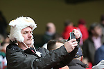 A Wales rugby fan taking a selfie.<br /> RBS 6 Nations<br /> Wales v Ireland<br /> Millennium Stadium<br /> 14.03.15<br /> ©Steve Pope - SPORTINGWALES