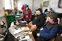 Iditarod race personel at McGrath work logistics on during Iditarod 2009