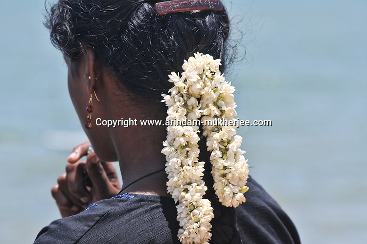 A South Indian woman decorates her hair with flowers, which is very much common in Pondicherry as well. Arindam Mukherjee.