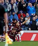Hearts players celebrate but the main stand linesman chalks it out