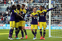 Pictured: Wilfried Bony of Swansea (2nd L) celebrating his goal with team mates L-R Marvin Emnes, Jordi Amat, Leon Britton and Jonathan de Guzman. He scored from the penalty spot after Marvin Emnes was brought dowin in the box in stoppage time. Saturday 19 April 2014<br /> Re: Barclay's Premier League, Newcastle United v Swansea City FC at St James Park, Newcastle, UK.
