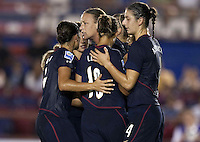 Abby Wambach of USA (center) celebrates her goal with teammates. USWNT vs Costa Rica in the 2010 CONCACAF Women's World Cup Qualifying tournament held at Estadio Quintana Roo in Cancun, Mexico on November 1st, 2010.