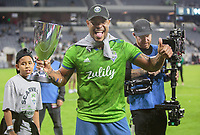 LOS ANGELES, CA - OCTOBER 29: Roman Torres #29 of the Seattle Sounders FC celebrate their MLS Western Conference victory over Los Angeles FC during a game between Seattle Sounders FC and Los Angeles FC at Banc of California Stadium on October 29, 2019 in Los Angeles, California.