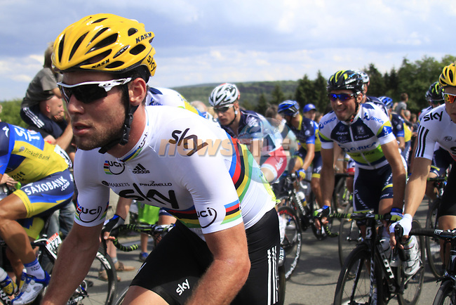 The peloton including World Champion Mark Cavendish (GBR)  Sky Procycling climbs the Cote De Barvaux during Stage 1 of the 99th edition of the Tour de France, running 198km from Liege to Seraing, Belgium. 1st July 2012.<br /> (Photo by Eoin Clarke/NEWSFILE)