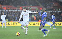 SWANSEA, WALES - JANUARY 17:   of  during the Barclays Premier League match between Swansea City and Chelsea at Liberty Stadium on January 17, 2015 in Swansea, Wales. Swansea's Gylfi Sigurdsson on the ball