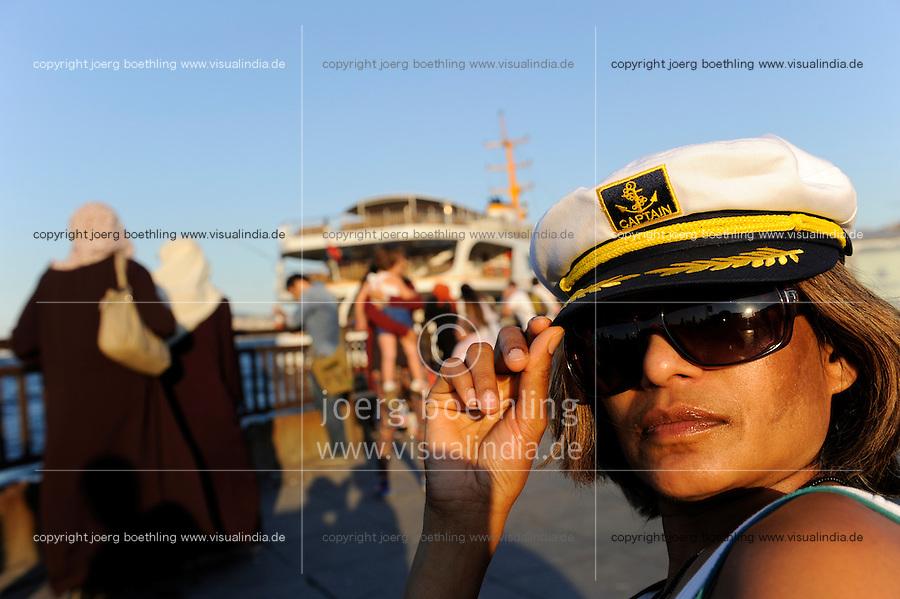 TURKEY Istanbul, woman with captain hat / TUERKEI Istanbul, Frau mit Kapitaen Muetze