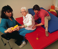 A senior woman receiving physical therapy at a rehabilitation hospital.