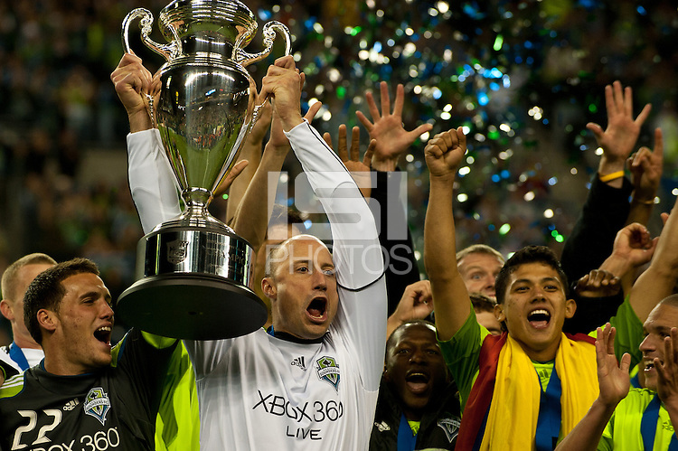 Seattle Sounders teammates Mike Seamon, Kasey Keller, Sanna Nyassi, and Fredy Montero (l to r) celebrate their 2010 US Open Cup Championship after defeating the Columbus Crew 2-1 at the XBox 360 Pitch at Quest Field in Seattle, WA on October 5, 2010.