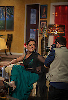 Saleem / Begum is being photographed on the set before the show starts