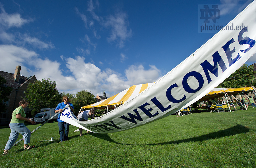 Aug. 17, 2012; Campus Ministry staff set up their welcome banner on South Quad for move-in 2012...Photo by Matt Cashore/University of Notre Dame
