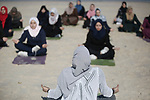 Palestinian women practise yoga on the beach in Gaza City on March 3, 2020 during an event organised by the the Positive Energy Club. Photo by Osama Baba