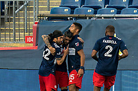 FOXBOROUGH, MA - SEPTEMBER 23: Gustavo Bou #7 of New England Revolution celebrates goal with teammates during a game between Montreal Impact and New England Revolution at Gillette Stadium on September 23, 2020 in Foxborough, Massachusetts.