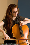 Middle School grade 8 music education girl playing cello vertical