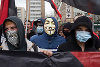 Moscow, Russia, 01/05/2011..Masked young anarchists, one wearing a Guy Fawkes mask, chant slogans as a mixture of Communist and anarchist anti-government groups demonstrate in central Moscow. A variety of political groups took to the streets on the traditional Russian Mayday holiday.
