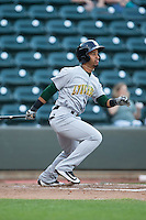 Ivan Castillo (2) of the Lynchburg Hillcats follows through on his swing against the Winston-Salem Dash at BB&T Ballpark on April 28, 2016 in Winston-Salem, North Carolina.  The Dash defeated the Hillcats 4-1.  (Brian Westerholt/Four Seam Images)