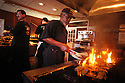 """Dudley Battie chargrills oysters at Drago's Seafood Restaurant and Oyster Bar in """"Fat City'' at one of the restaurant's five natural gas chargrills, in Metairie, Louisiana, May 23, 2003. The restaurant serves about 600 dozen chargrilled oysters on a busy day..(AP PHOTO/CHERYL GERBER).Louisiana Seafood.."""