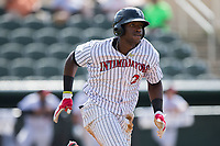 Micker Adolfo (27) of the Kannapolis Intimidators hustles down the first base line against the Hagerstown Suns at Kannapolis Intimidators Stadium on July 9, 2017 in Kannapolis, North Carolina.  The Intimidators defeated the Suns 3-2 in game one of a double-header.  (Brian Westerholt/Four Seam Images)