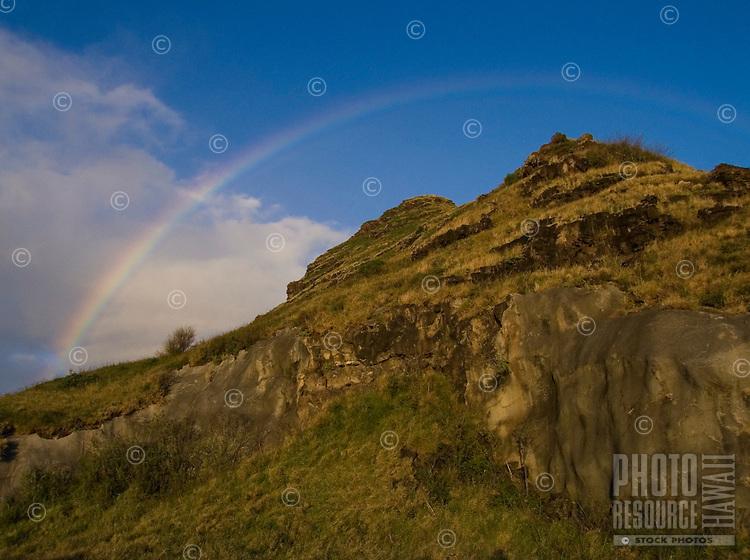 A rainbow over the Wai'anae Range (or Mountains), as seen from Ka'ena Point, O'ahu.