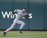 Ichiro Suzuki of the Seattle Mariners chases a fly ball during a 2002 MLB season game against the Los Angeles Angels at Angel Stadium, in Los Angeles, California. (Larry Goren/Four Seam Images)