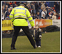 08/03/2003                   Copyright Pic : James Stewart.File Name : stewart-falkirk v alloa 06.THE POLICE STRUGGLE TO CONTROL A HALF TIME PITCH INVASION BY ONE THE YOUNG JUNIOR BAIRNS....James Stewart Photo Agency, 19 Carronlea Drive, Falkirk. FK2 8DN      Vat Reg No. 607 6932 25.Office     : +44 (0)1324 570906     .Mobile  : +44 (0)7721 416997.Fax         :  +44 (0)1324 570906.E-mail  :  jim@jspa.co.uk.If you require further information then contact Jim Stewart on any of the numbers above.........