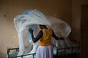 Uganda - Adjumani - A South Sudanese caretaker prepares the mosquito nets for the children's bed at the orphanage.<br /> Created in 1994, the orphanage is managed by South Sudanese International Widows Association to Save Orphans and moved in February 2017 from the South Sudanese city of Kajo-Keji to Uganda because of security reasons. It currently hosts 55 children in the city of Adjumani and an additional 27 in Palorinya refugee camp.