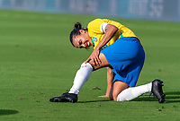 ORLANDO, FL - FEBRUARY 18: Marta #10 of Brazil holds her knee during a game between Argentina and Brazil at Exploria Stadium on February 18, 2021 in Orlando, Florida.