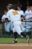 First Baseman Davis Morgan #30 runs to first during a  game against the Kentucky Wildcats at Lindsey Nelson Stadium on March 24, 2012 in Knoxville, Tennessee. The game was suspended in the bottom of the 5th with the Wildcats leading 5-0. Tony Farlow/Four Seam Images.