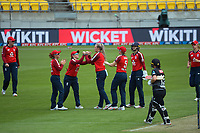 England players celebrate the wicket of Maddy Green during the first international women's T20 cricket match between the New Zealand White Ferns and England at Sky Stadium in Wellington, New Zealand on Wednesday, 3 March 2021. Photo: Dave Lintott / lintottphoto.co.nz