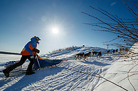 Mats Pettersson runs up the bank of the Yukon River and into  the Kaltag checkpoint during the 2017 Iditarod on Sunday afternoon March 12, 2017.<br /> <br /> Photo by Jeff Schultz/SchultzPhoto.com  (C) 2017  ALL RIGHTS RESERVED