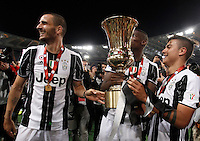 Calcio, finale Tim Cup: Milan vs Juventus. Roma, stadio Olimpico, 21 maggio 2016.<br /> From left, Juventus's Giorgio Chiellini, Paul Pogba and Paulo Dybala hold the trophy at the end of the Italian Cup final football match between AC Milan and Juventus at Rome's Olympic stadium, 21 May 2016. Juventus won 1-0 in the extra time.<br /> UPDATE IMAGES PRESS/Isabella Bonotto