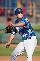 Marcus Crescentini (52) of the Ogden Raptors delivers a pitch to the plate against the Grand Junction Rockies in Pioneer League action at Lindquist Field on July 5, 2015 in Ogden, Utah. Ogden defeated Grand Junction 12-2.  (Stephen Smith/Four Seam Images)