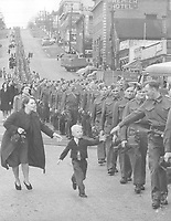"""Wait for me daddy"":British Columbia Regiment, DCO, marching in New Westminster, 1940 (LP 109)"