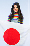 Camila Cabello, a member of the American five-piece girl group Fifth Harmony holds a Japanese flag during a fan event on July 9, 2016, in Tokyo, Japan. Fifth Harmony is in Japan for the first time to promote their new song Work from Home after finishing their South American tour. (Photo by Rodrigo Reyes Marin/AFLO)