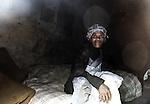 Grand mère swazi.Le Swaziland est l'un des plus pauvre du monde et offre un contraste frappant avec les frasques et les dépenses somptuaires du Roi Mswati III.<br /> <br /> Paysanne dans les montagnes du Swaziland. le pays est l'un des plus pauvre du monde et offre un contraste frappant avec les frasques et les dépenses somptuaires du Roi Mswati III.<br /> <br /> <br /> Swazi Grand mother in her home. Mostly agricultural, the kingdom is one of the poorest in the world and offers a striking contrast to lavish spending of King Mswati III.