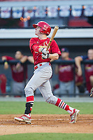 Blake Drake (40) of the Johnson City Cardinals follows through on his swing against the Burlington Royals at Burlington Athletic Park on July 14, 2014 in Burlington, North Carolina.  The Cardinals defeated the Royals 9-4.  (Brian Westerholt/Four Seam Images)