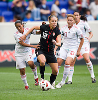 Lauren Cheney (12) of the USWNT keeps the ball away from Eve Lopez (7) and Dinora Garza (10) of Mexico during the game at Red Bull Arena in Harrison, NJ.  The USWNT defeated Mexico, 1-0.