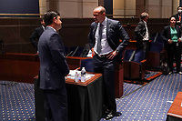 Rep. Mike Johnson (R-La.) speaks to Daniel Bongino, conservative radio show host, before a House Judiciary Committee hearing to discuss police brutality and racial profiling on Wednesday, June 10, 2020.<br /> Credit: Greg Nash / Pool via CNP/AdMedia