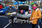 Joanne O'Connor helping Geraldine O'Shea with a delivery to her car at the Farmers Market on Saturday.