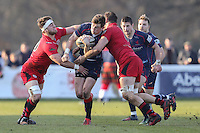 Peter Lydon of London Scottish (2nd left) looks for a way through Max Argyle of Jersey Reds (left) and Nick Haining of Jersey Reds (3rd left) during the Greene King IPA Championship match between London Scottish Football Club and Jersey at Richmond Athletic Ground, Richmond, United Kingdom on 18 February 2017. Photo by David Horn / PRiME Media Images.
