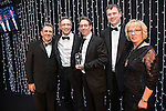 © Joel Goodman - 07973 332324 . 05/03/2015 .  Midland Hotel , Manchester , UK . L-R Eamonn O'Neill , winners Bott and Co Solicitors , sponsor ( Weightmans ) and Louise Straw . Small Law Firm of the Year . The Manchester Legal Awards 2015 . Photo credit : Joel Goodman