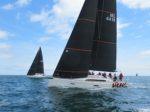 XP 44 with a Harken carbo foil and a First 50 with a Furler. Both Unit Titanium headsail. The XP 44 has horizontal battens. The First 50 has Vertical battens for furling. There are no compromises in sail shape in both set ups