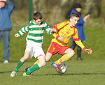 8 of Knocklyon FC in action against Colm O Loghlen of Avenue United during their SFAI game at Lisdoonvarna. Photograph by John Kelly.