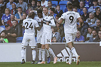 Ryan Sessegnon of Fulham (2nd L) celebrates his goal with co-scorer Andre Schurrle and team mates Jean Michael Seri (L) and Aleksandar Mitrovic during the Premier League match between Cardiff City and Fulham FC at the Cardiff City Stadium, Wales, UK. Saturday 20 October 2018